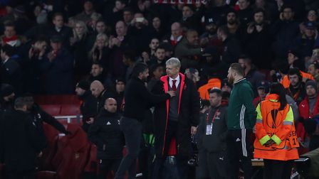 The two managers shake hands at the final whistle in the Europa League match between Arsenal and A.C