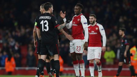 Danny Welbeck shakes hands with A.C. Milan players at the final whistle after the Europa League matc