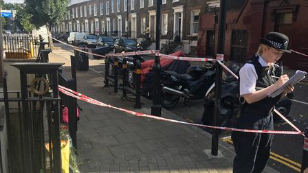 Police at the scene in Mitchison Road, Canonbury. Picture: James Morris