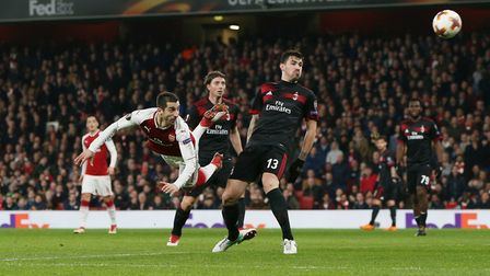 Henrikh Mkhitaryan sends a diving header wide in the Europa League match between Arsenal and A.C. Mi