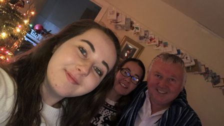 Rebecca with her parents Nikki and Ray Holden who are walking 225 miles to help fund her rehabilitat