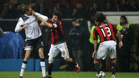 AC Milan's Gennaro Gattuso (centre) pushes Tottenham Hotspur's Peter Crouch (left) during the match
