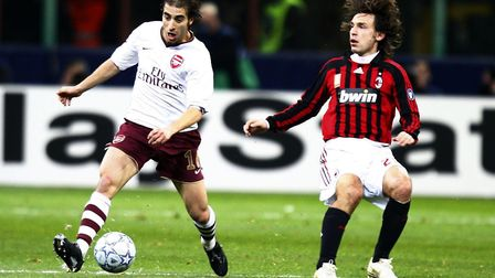 Arsenal's Mathieu Flamini (left) in action with AC Milan's Massimo Oddo at the San Siro in 2008 (pic