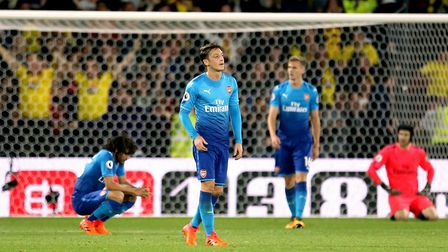 Arsenal's Mesut Ozil appears dejected after Watford's Tom Cleverley (not in picture) scores his side