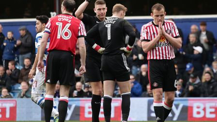 Sunderland goalkeeper Jason Steele is shown the red card by the referee during the Sky Bet Champions