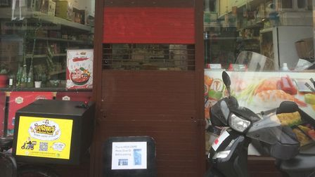 The shutters are down at Oriental Food in Junction Road. Picture: Tom Bartley
