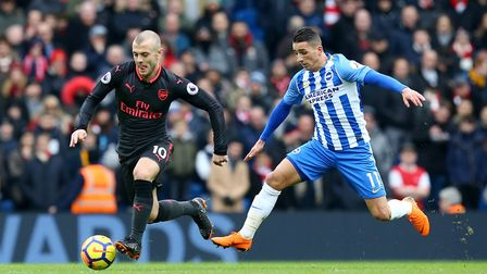 Arsenal's Jack Wilshere (left) and Brighton & Hove Albion's Anthony Knockaert battle for the ball (p
