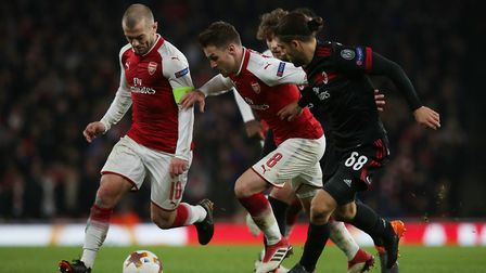 Jack Wilshere and Aaron Ramsey work together to squeeze through the Milan defence in the Europa Leag