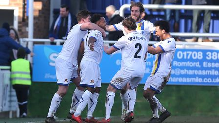 Matthew Whichelow of Wealdstone scores the fourth goal for his team and celebrates with his team mat