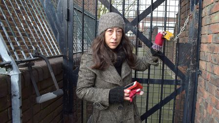 'Left adrift': Adelaide Guedes by the locked gate in the Popham Estate. Picture: Polly Hancock