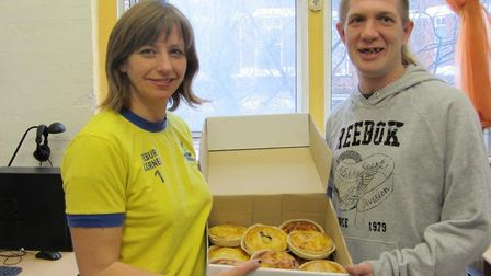 Piebury Corner's Nicky Campbell delivers leftover pies to the Pilion Trust back in 2012. Picture: Pi