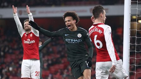 Manchester City's Leroy Sane celebrates scoring his side's third goal of the game during the Premier