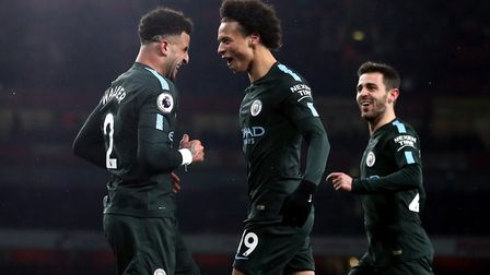 Manchester City's Leroy Sane (centre) celebrates scoring his side's third goal of the game with Kyle