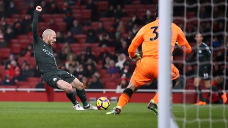 Manchester City's David Silva fires past Arsenal goalkeeper Petr Cech to make it 2-0 at Emirates Sta