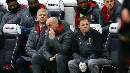 Arsenal manager Arsene Wenger and staff look on (pic Gareth Fuller/PA)