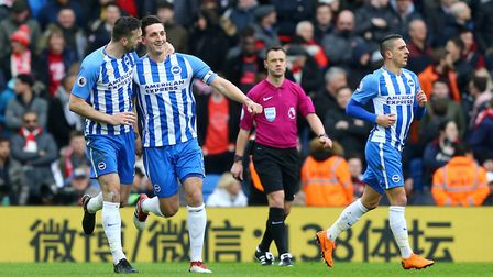 Brighton & Hove Albion's Lewis Dunk (second left) celebrates scoring his side's first goal (pic Gare