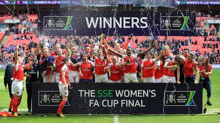 Arsenal players celebrate after winning the 2016 SSE Women's FA Cup Final at Wembley Stadium (pic Ni