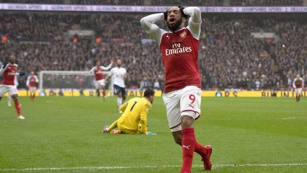 Arsenal's Alexandre Lacazette looks dejected after seeing a late chance go wide at Wembley Stadium (