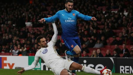 Sead Kolasinac is tackled by Sotirios Papagiannopoulos in the Europa League match between Arsenal vs