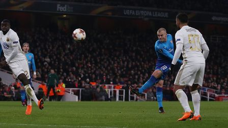 Jack Wilshere shoots high and wide after the ball fell kindly to him in the area during the Europa L