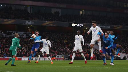 Danny Welbeck flicks a free kick into the grateful arms of Ostersund keeper Aly Keita in the Europa