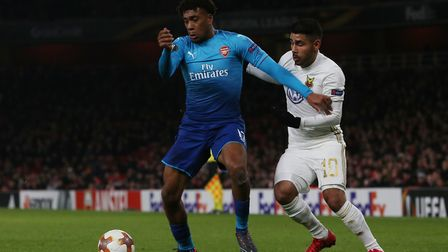 Alex Iwobi holds off Hosam Aiesh in the Europa League match between Arsenal vs Ostersunds FK at the