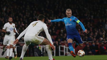 Jack Wilshere lines up a shot from the edge of the area in the Europa League match between Arsenal v