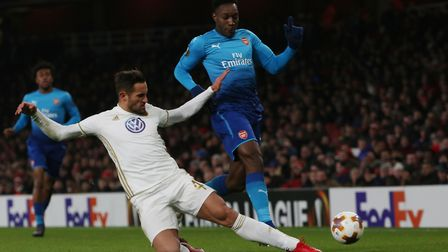 Danny Welbeck is tackled by Sotirios Papagiannopoulos in the Europa League match between Arsenal vs