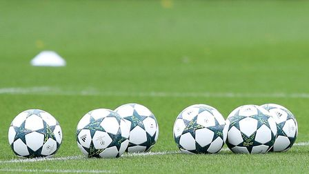 A pile of footballs lie ready to be used (pic Andrew Matthews/PA)