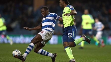 Nedum Onuoha of Queens Park Rangers clears his lines under pressure from Cameron Jerome of Derby Cou