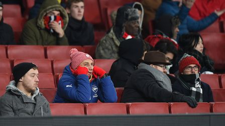 Dejected Arsenal fans at the Emirates Stadium during Thursday's game against Manchester City. Pictur