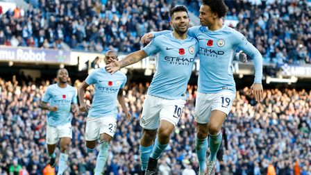 Manchester City's Sergio Aguero (left) celebrates scoring his side's second goal of the game with te