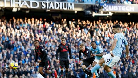 Manchester City's Sergio Aguero scores his side's second goal of the game during the Premier League