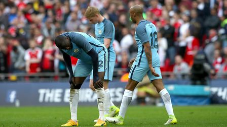 Manchester City's Yaya Toure shows his dejection during the Emirates FA Cup, Semi Final match at Wem