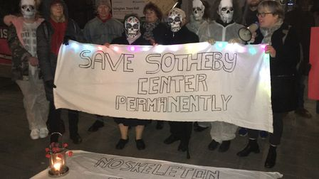 'Save Sotheby Mews' campaigners dressed as skeletons on the town hall steps ahead of last night's fu