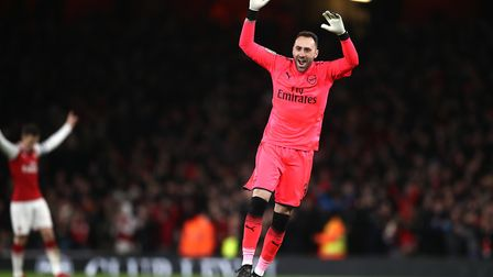 Arsenal goalkeeper David Ospina celebrates his side's second goal during the Carabao Cup semi final,