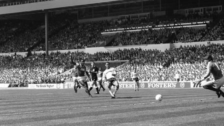 Luton Town's Brian Stein (c) steers the ball past Arsenal's John Lukic (r) to score the opening goal