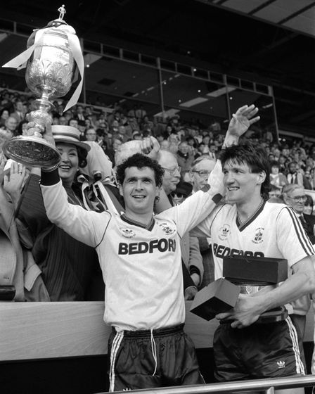 Luton Town captain Steve Foster holds the Littlewoods Challenge Cup aloft at Wembley after his team