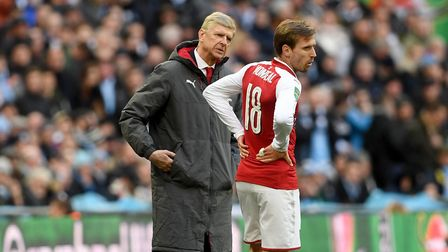 Arsenal manager Arsene Wenger (left) speaks with Arsenal's Nacho Monreal (right) during the Carabao
