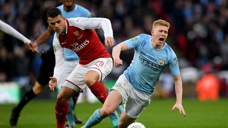 Manchester City's Kevin De Bruyne (right) and Arsenal's Granit Xhaka (left) battle for the ball duri