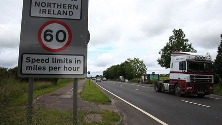 Traffic crossing the border between the Republic of Ireland and Northern Ireland in the village of B