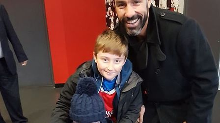 Arsenal legend Robert Pires with Harley in the ground-breaking sensory room at the Emirates