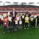 Per Mertesacker helping raise awareness for World Down Syndrome Day with young Gunners fans. Credit