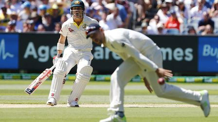 Australia's David Warner hits a shot past Dawid Malan during day one of the Ashes Test at the Melbou
