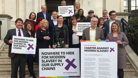 Reps from all seven councils, as well as Jeremy Corbyn, after the modern slavery charter was signed