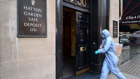 A file photo from April 2015 of a forensics officer entering the Hatton Garden Safe Deposit company.