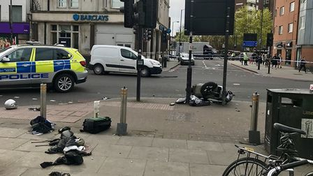Police in Seven Sisters Road, outside Finsbury Park station, this morning, after a serious moped cra