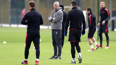 Arsenal manager Arsene Wenger (centre) during a training session at London Colney (pic Tim Goode/PA)