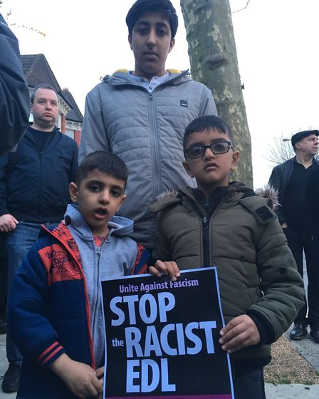 Choudry brothers Mehtab, 15, Ziyad, five, and Zain, six, at the Dollis Hill vigil. Picture: Nathalie