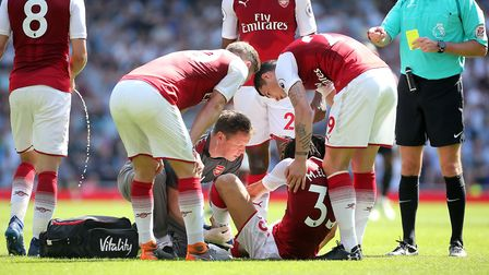 Arsenal's Mohamed Elneny (centre) on the ground after picking up an injury (pic Mark Kerton/PA)